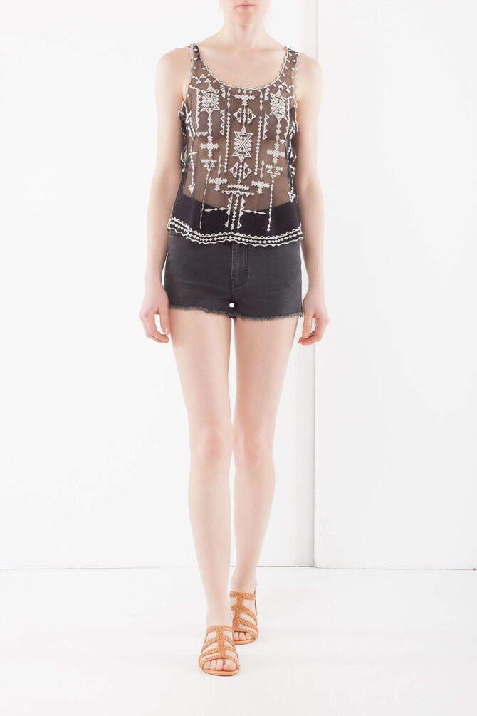 Top with contrast color embroideries