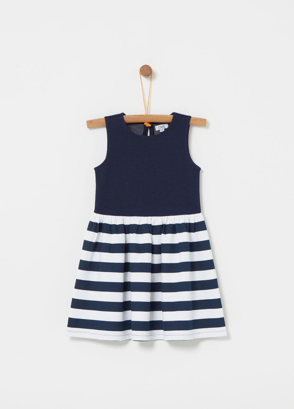 Sleeveless dress with striped skirt