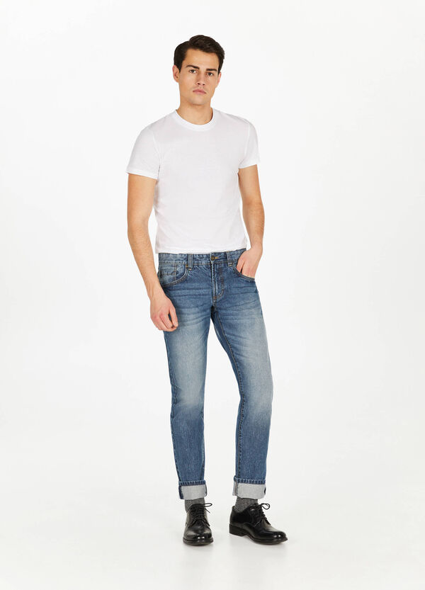 Jeans straight fit used con scoloriture