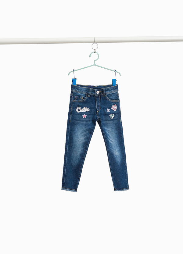 Stretch jeans with patches and sequins