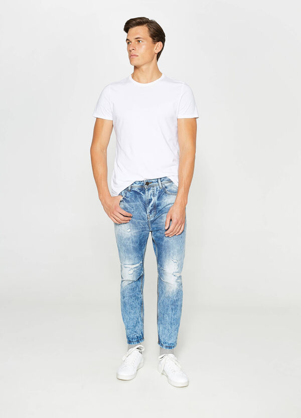 Jeans loose fit maltinti con strappi