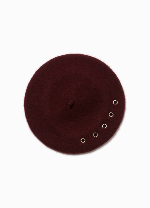 Solid colour wool beret with eyelets