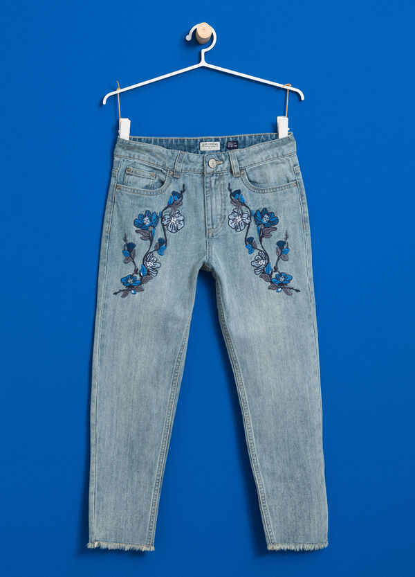 Faded jeans with floral embroidery