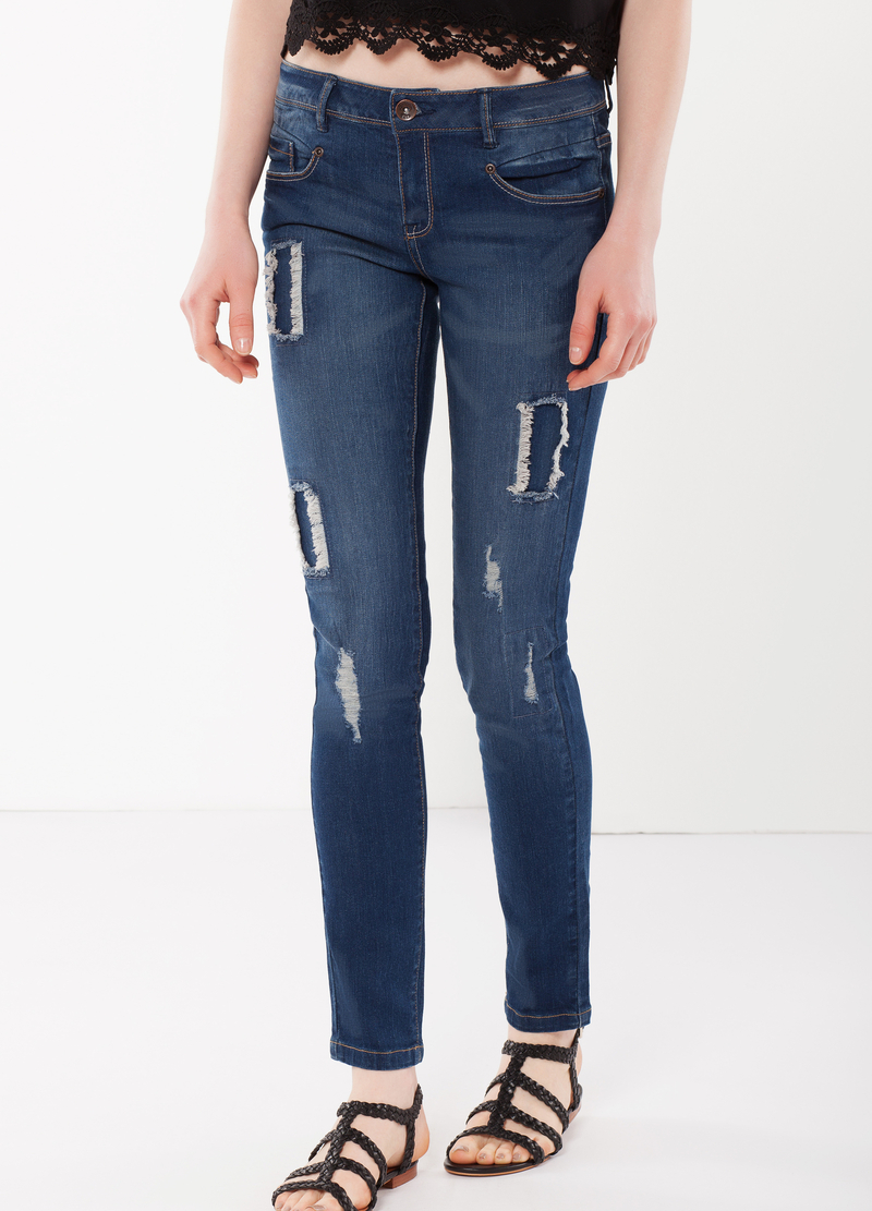 Heavily distressed jeans image number null