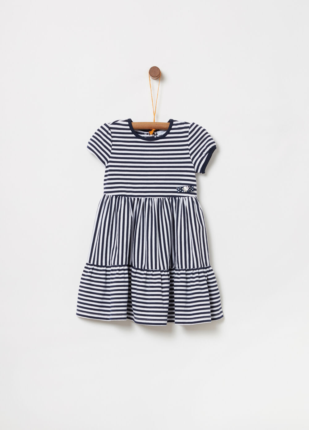 Dress with flounce and striped bow