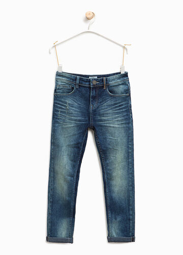 Worn-effect jeans with whiskering and abrasions