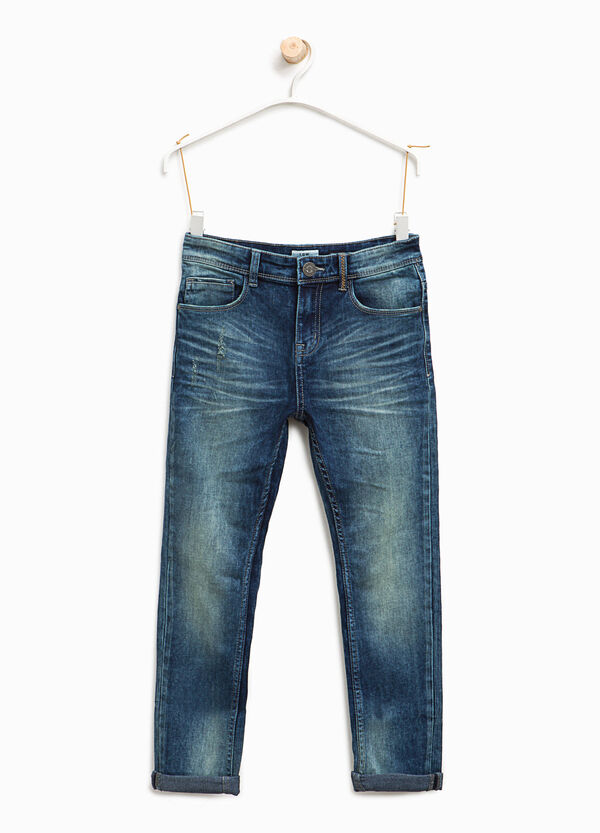 Worn-effect jeans with whiskering and abrasions | OVS