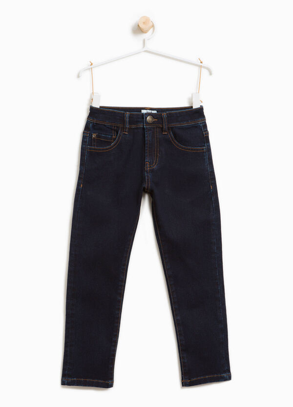 Solid colour stretch jeans with button | OVS