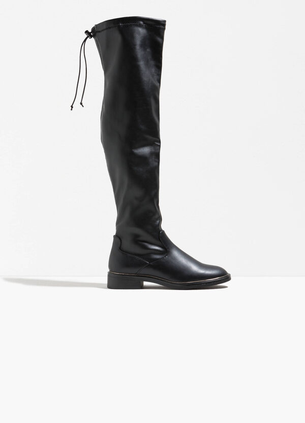 Boots with drawstring and rubber soles
