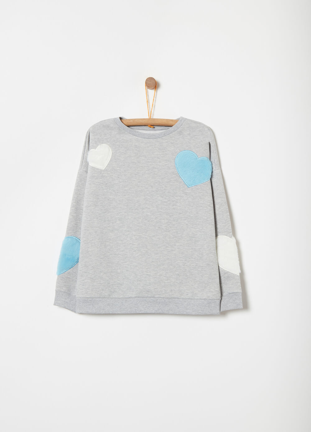 Sweatshirt with faux fur heart applications