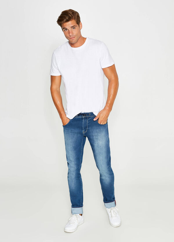 Worn-effect slim-fit stretch jeans with drawstring | OVS