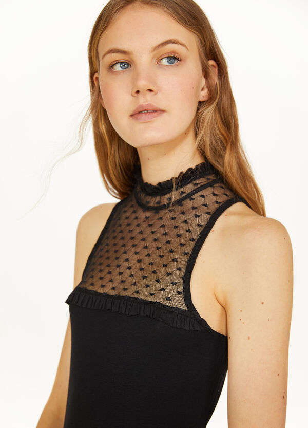 Semi-sheer top with high neck and hearts