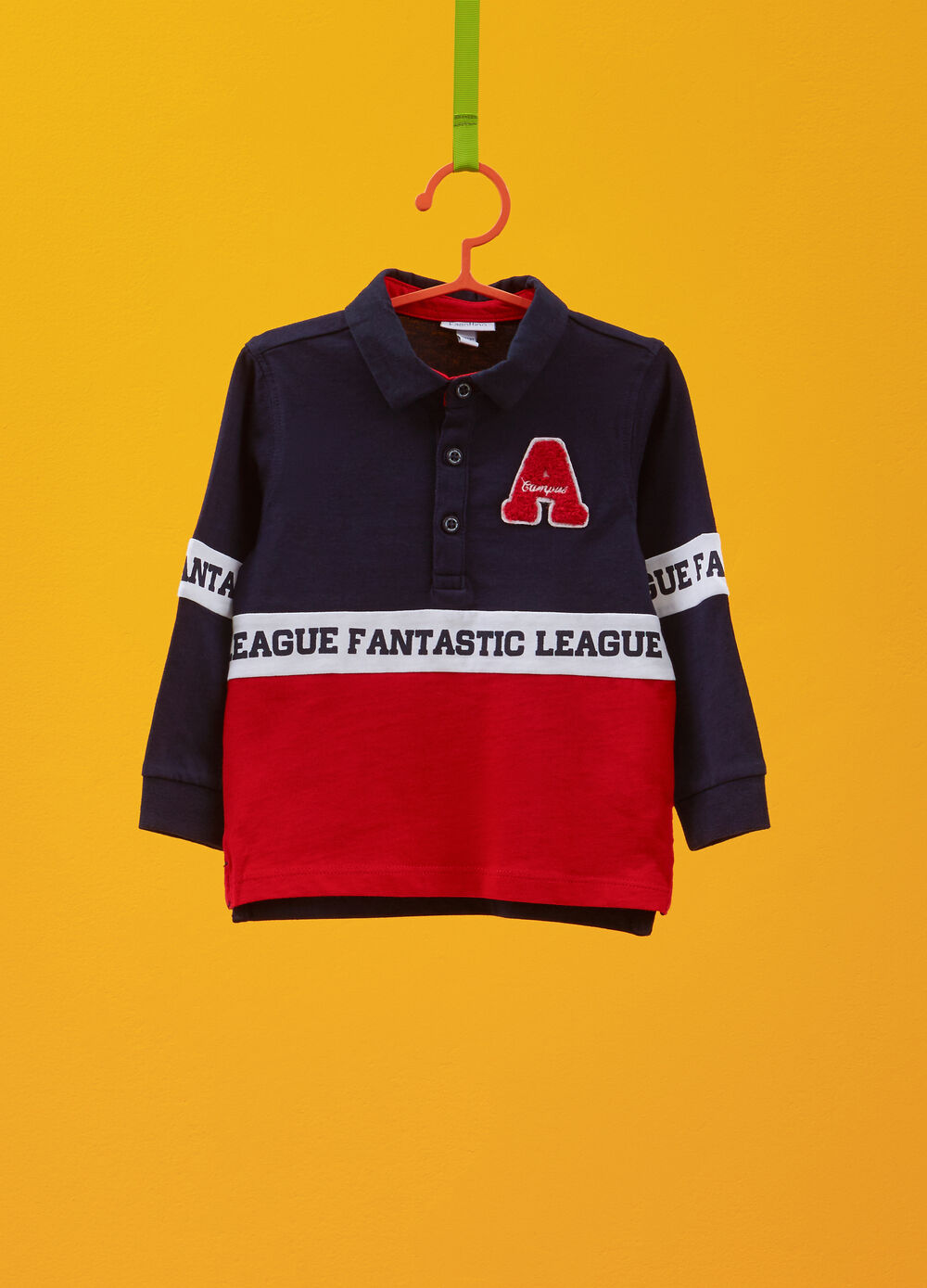 Cotton polo shirt with patches and printed lettering