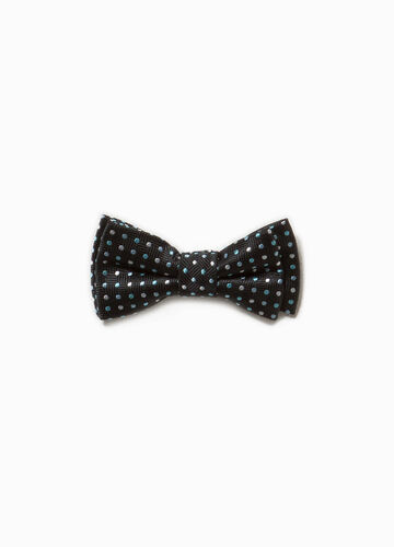 Bow tie with diamond weave and polka dot pattern.