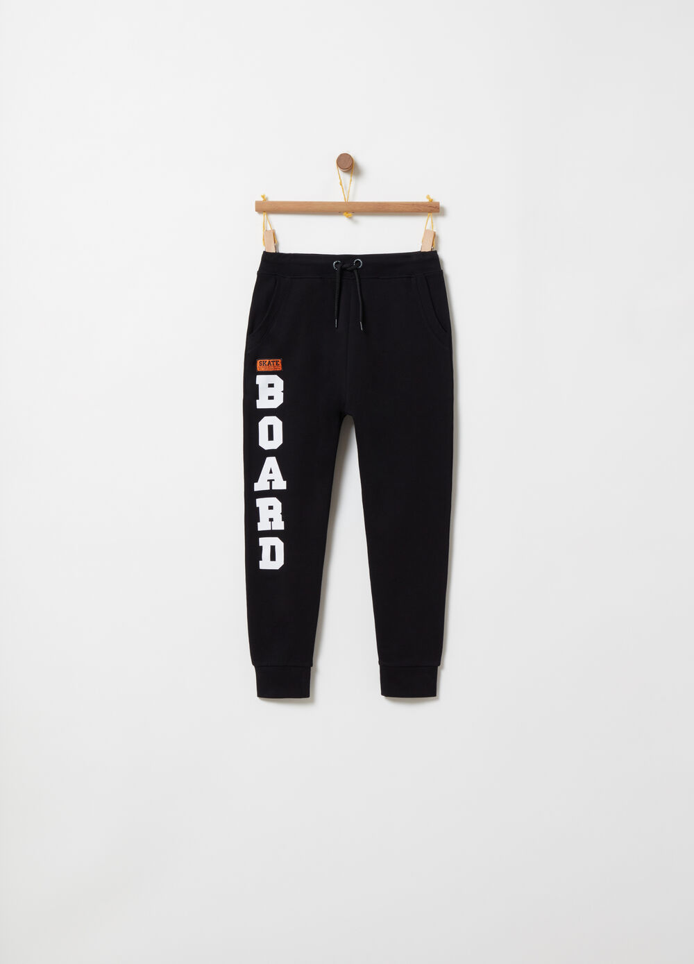Trousers with low crotch, print and label