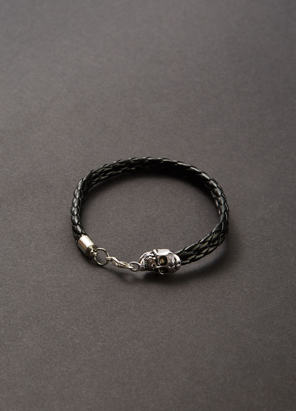 Bracelet with woven wires and skull