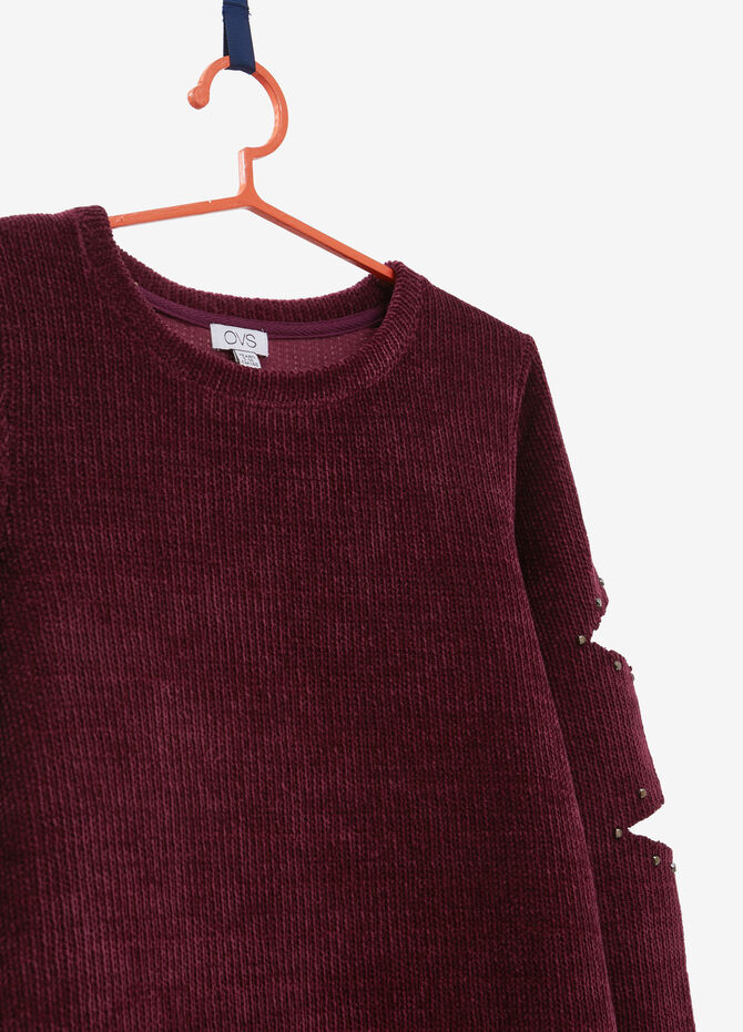 Knitted pullover with openings and studs