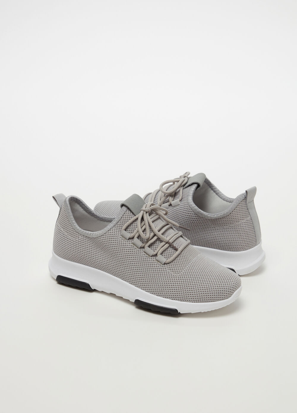 Sneakers with mesh upper and thick sole