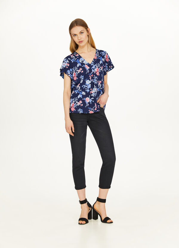 V-neck blouse with contrasting pattern