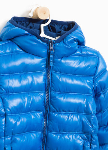 Solid colour jacket with large hood.
