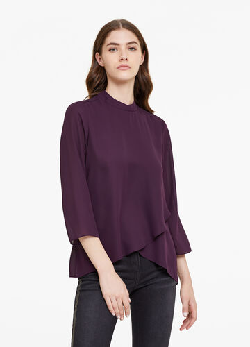 Blouse with high neck and crossover