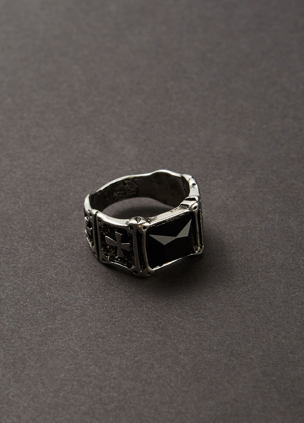 Metal ring with low-relief work and stone