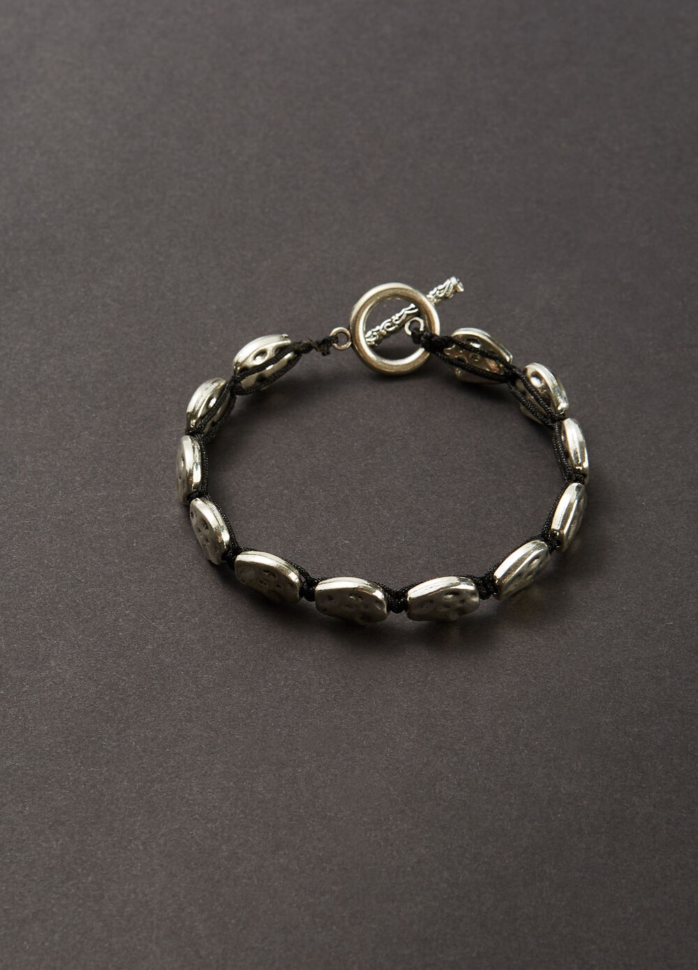 Steel bracelet with plaited wire