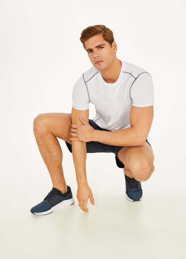 Stretch shorts with openwork bands