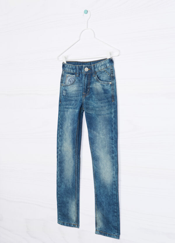 Worn-effect, ripped jeans | OVS