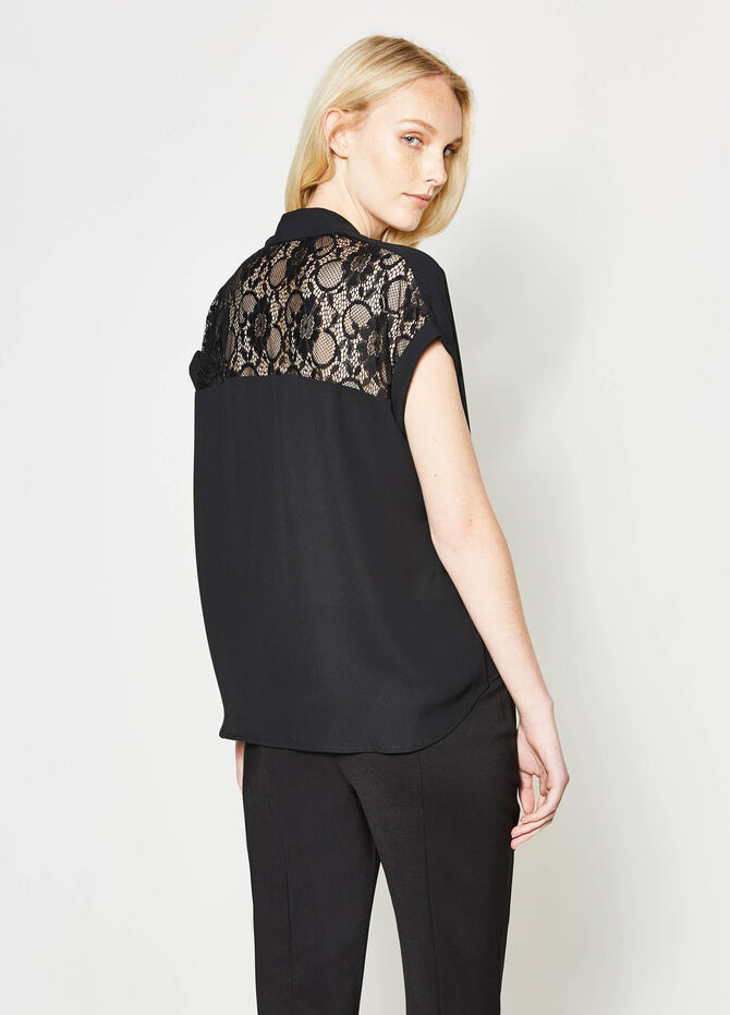 Blouse with lace and crossover baffle