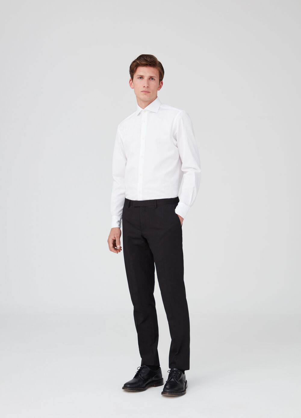 Stretch trousers with welt pockets