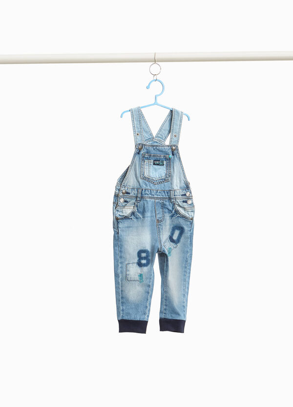 Denim dungarees with embroideries and patches