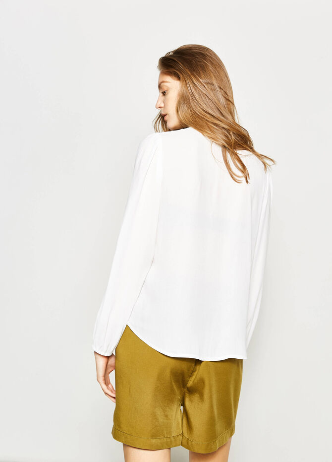 Openwork blouse with tassels