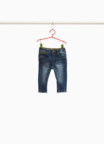 Worn-effect jeans with inserts
