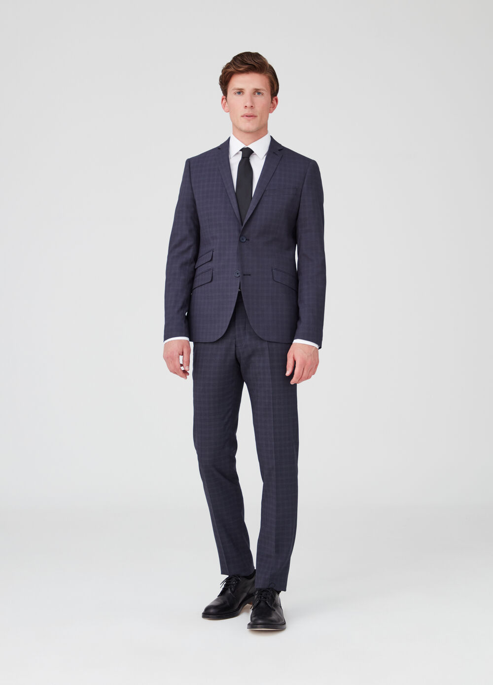 Suit with two-button jacket and check trousers