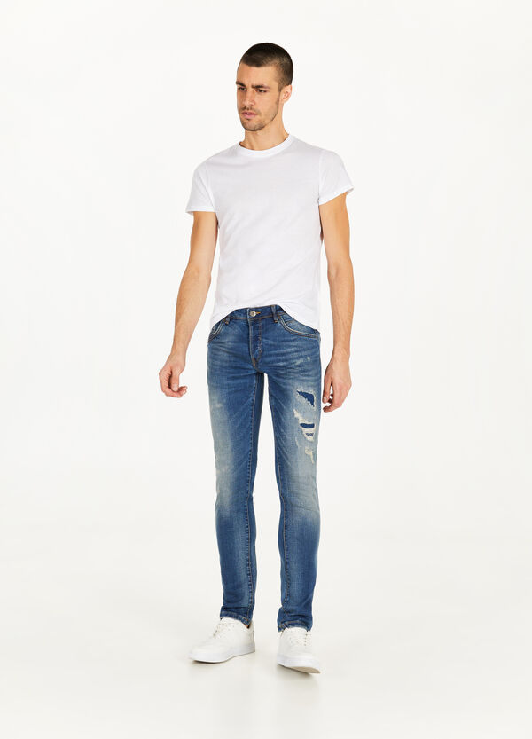 Jeans slim fit stretch con strappi