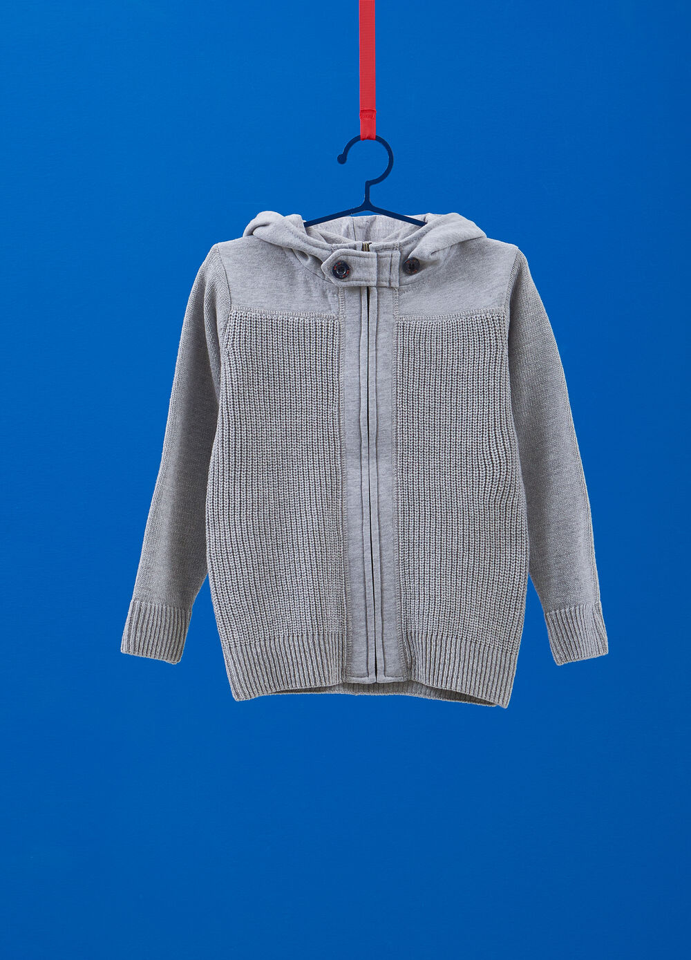 Knitted cardigan with inserts and hood