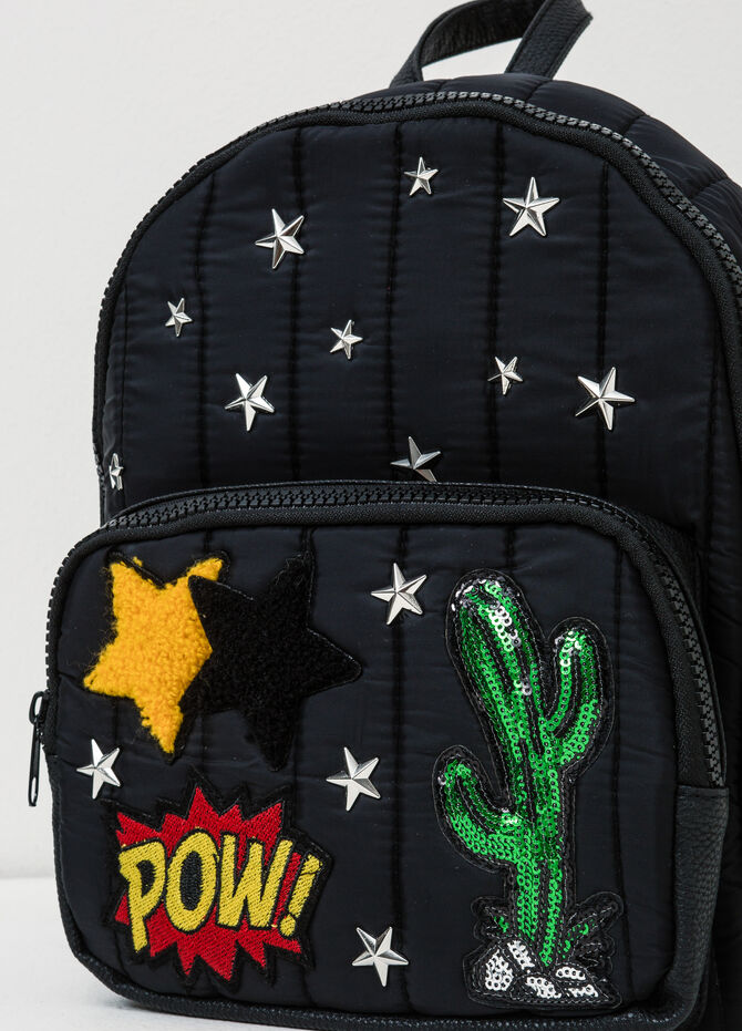 Backpack with star-shaped stud design.