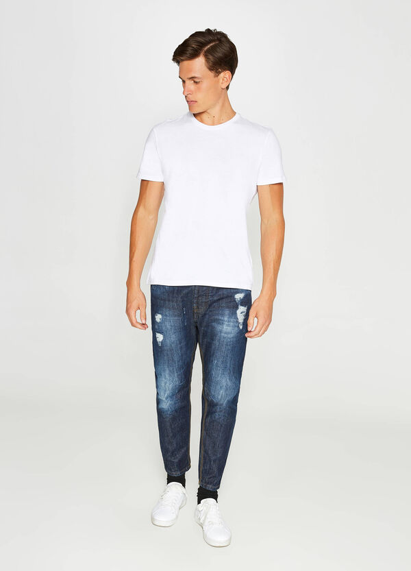 Jeans loose fit maltinti con abrasioni
