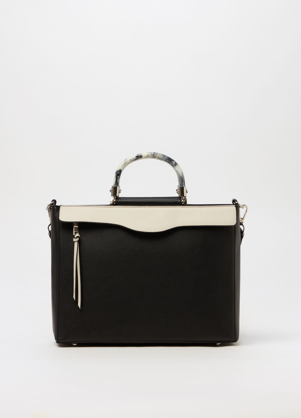 Handbag with contrasting solid handles
