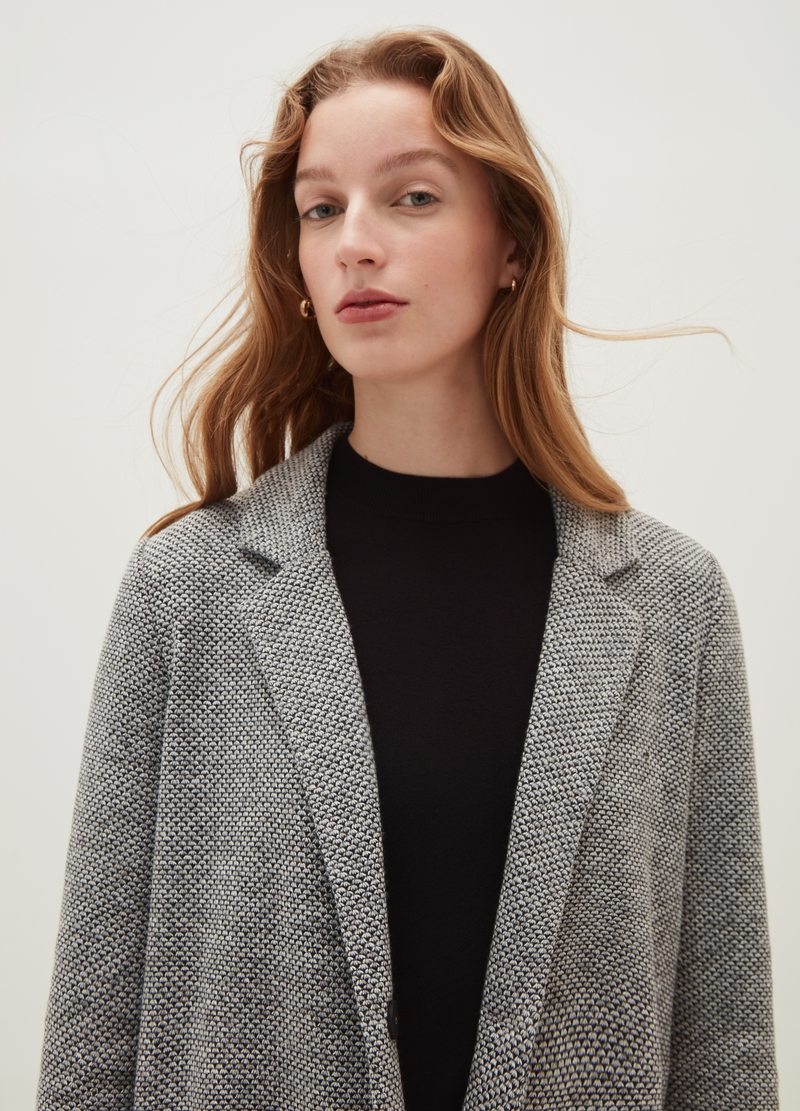 Cappotto con revers trama geometrica image number null
