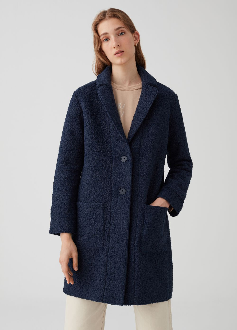 Coat with faux-fur lapels