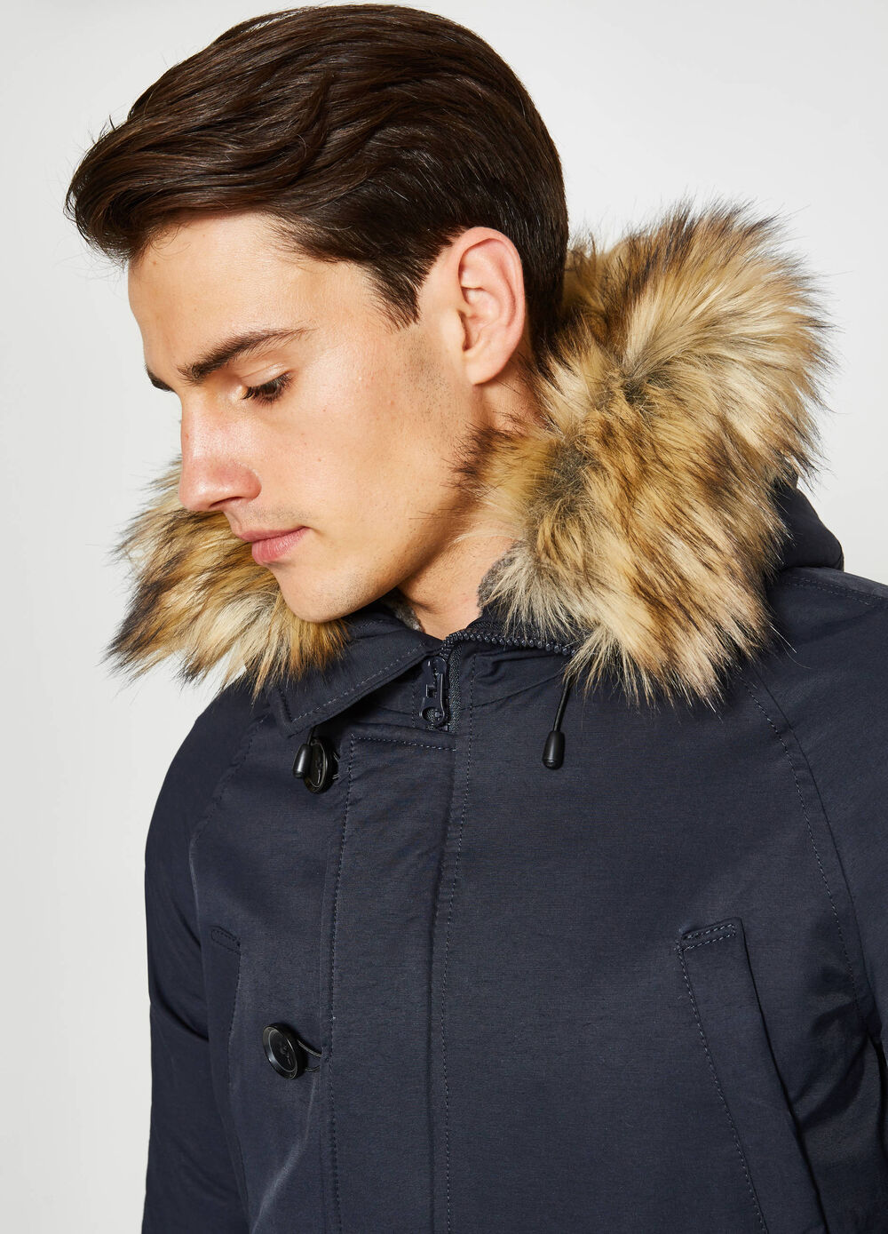 Jacket with hood and faux fur