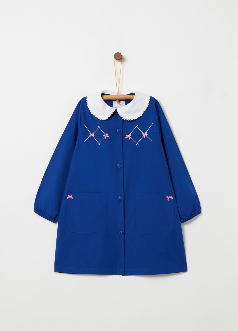 School smock with trim bows and pockets
