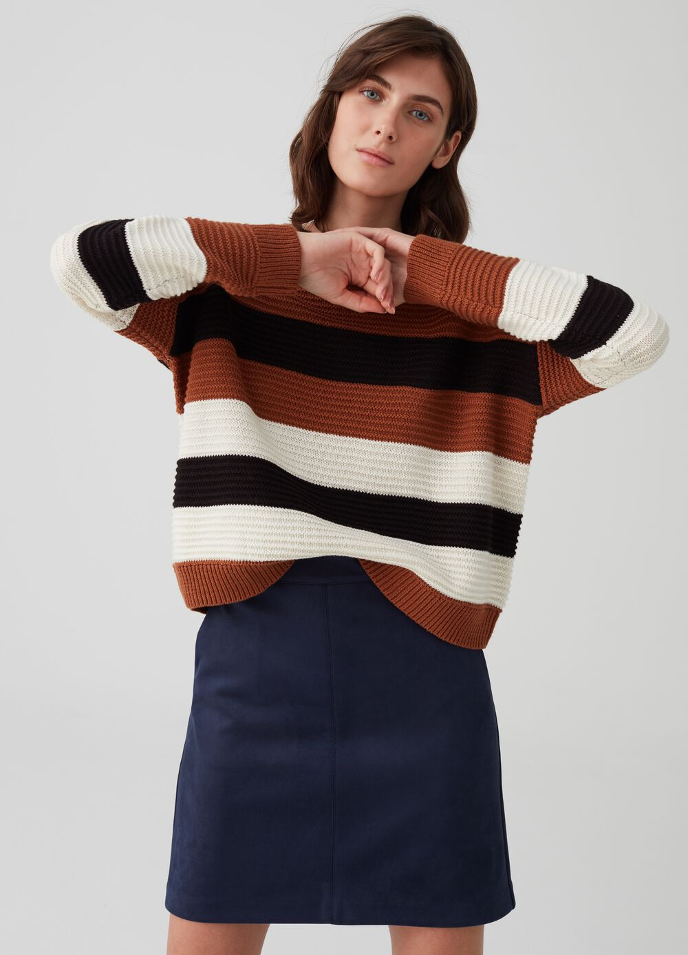 Knitted pullover with buttons and striped pattern
