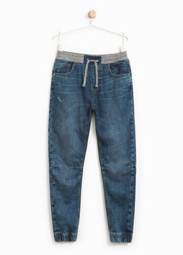Worn-effect jeans with elasticated waist