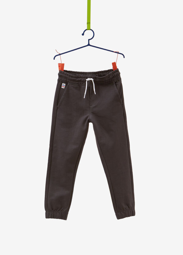 Trousers in 100% cotton with patch and drawstring