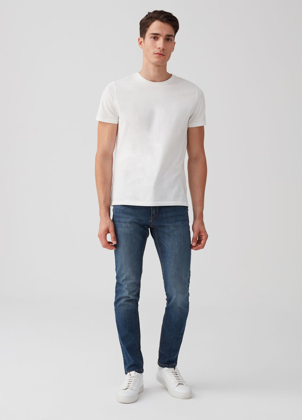 Skinny-fit stretch jeans with fading and pockets