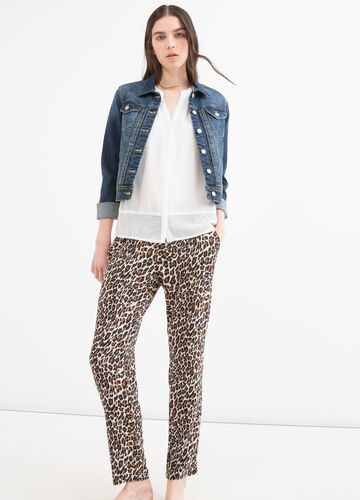 Stretch trousers with animal pattern