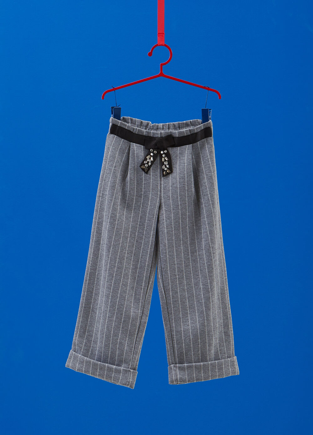Stretch trousers with bow and striped pattern